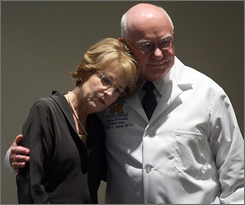 Mary Sue Coleman, University of Michigan president, and Dr. Robert Kelch, executive vice president for medical affairs, console each other after speaking to reporters about the Monday's plane crash carrying a six-member University of Michigan organ transplant team.