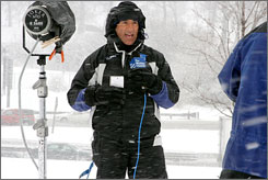 On-camera meteorologist Jim Cantore covers a winter storm in Milwaukee, Wis.