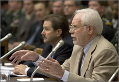 "Murray Neal, CEO of Pinnacle Armor, center left, and Philip Coyle, senior adviser of the World Security Institute, center right, testify on Defense Department body armor programs at the U.S. Capitol in Washington, D.C., Wednesday. Pinnacle Armor, based in Fresno, Calif., manufactures the protective vest called the ""Dragon Skin."""
