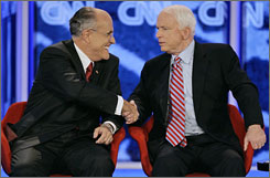Former New York City Mayor Rudy Giuliani, left, and Sen. John McCain shake hands at the end of the Republican presidential primary debate in Manchester, N.H., Tuesday. Giuliani and McCain both intend to skip the Ames straw poll in Iowa, in August.