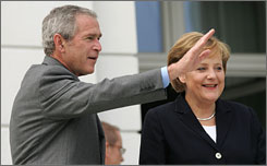 President Bush and German Chancellor Angela Merkel arrive for bilateral talks at the G-8 summit Wednesday in Heiligendamm, Germany. 