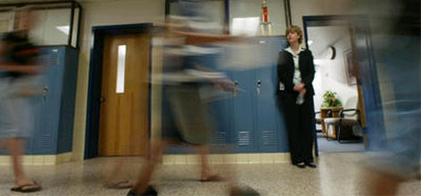 May is test time:Principal Marti Jackson watches students walk to class at Robert Frost Middle School in Fairfax, Va. The middle school tests students in May under the 2002 federal No Child Left Behind law, which was designed to raise education standards across the country.