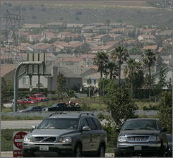 Homes dot the landscape of Fontana, Calif., in San Bernardino County. The county has been sued for failing to account for greenhouse gases when it updated its 25-year growth plan.