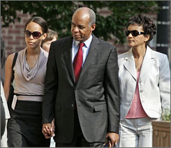 Jefferson, with members of his family, arrives at federal court in Alexandria, Va., on Friday.