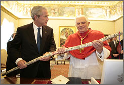 President Bush gave the pope a walking stick made by a formerly homeless Texas artist who carved the Ten Commandments on the wood.