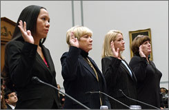 Relatives of four slain Blackwater USA contractors, from left, Kristal Batalona, Kathryn Helvenston-Wettengel, Rhonda Teague and Donna Zovko, testify at a House hearing in Washington, D.C., in February. The families are suing Blackwater in the hope that their questions on what happened to their loved ones in Fallujah will be answered.