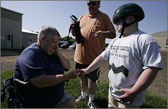Teri Russo, left, checks her son, Damian's heart rate after his equestrian lesson in Spring Valley, N.J. Russo adopted four boys with Downs Syndrome, all of whom participate in Special Olympics.