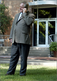 Antioch College President Steven Lawry fields phone calls following the announcement the historic college will suspend operations in July of 2008 due to declining enrollment and revenues Tuesday, in Yellow Springs, Ohio.