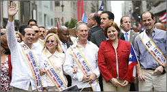 Governor of Puerto Rico Anibal Acevedo-Vila, left, New York City Mayor Michael Bloomberg, center, New York City Council speaker Christine Quinn, second right, and Governor of New York Eliot Spitzer, right, attend the 50th Anniversary of the National Puerto Rican Day Parade along 5th Avenue Sunday in New York City.