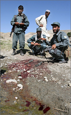 Afghan police officers gather where their colleagues were mistakenly killed in Khogyani district of Nangarhar province, east of Kabul, Afghanistan.
