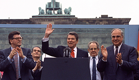 "Reagan acknowledges the crowd after his speech in front of the Brandenburg Gate in West Berlin on June 12, 1987. At the time, though, it received a muted reception. But two decades later, the speech has passed into history as one of the ""great communicator's"" most stirring moments."