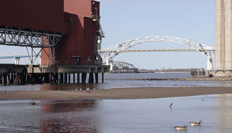 A sandbar rises above water level in a channel between the coal loading dock and grain elevators along St. Louis Bay in Superior, Wis. Lake Superior has 3 quadrillion gallons of water -- enough to submerge North and South America in a foot of water.