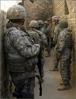 U.S. soldiers prepare to conduct a random search in Baghdad on June 7. In February, a new security effort  known as Operation Fardh al-Qanoon  was launched in the capital.