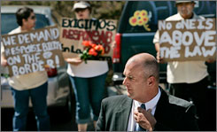 Border Patrol agent Nicholas Corbett stands before a group of protesters from the Border Action Network outside the Cochise County Justice Court #1 in Bisbee, Ariz., Friday, June 15, 2007, after his preliminary hearing in the fatal shooting of an illegal alien.