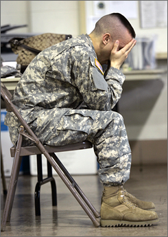 David Nobilese waits during a post-deployment health reassessment at the Pennsylvania Army National Guard Armory in Lock Haven on March 25. The state Guard has less than 50% of the equipment it needs to respond to emergencies; some trucks are up to 40 years old.
