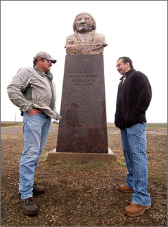 Rhett Albers, left, and Bryan Defender have big development plans for  the Sitting Bull monument. They say people who come to the banks of the Missouri to see the site are confused  wondering: Well, where is the rest of it?