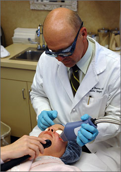 A. Jay Burns performs fraxel laser resurfacing on Rhonda Dennison, 42, at his Dallas office. Burns is president of the American Society for Laser Medicine and Surgery.