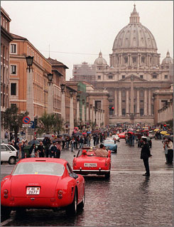 "Vintage Ferraris parade past St. Peter's Basilica in downtown Rome. The fifth of the recently released Drivers' Commandments states that ""cars shall not be for you an expression of power and domination, and an occasion of sin."""