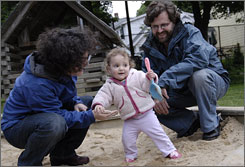 Nikki Horberg Decter and husband Jonathan play with 15-month-old Lila, whom they'll send to a different, more stimulating day care center in the fall.