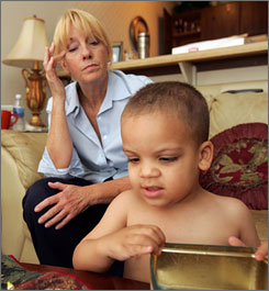 Patty Porter sits with her 2-year-old grandson, Blake, on Saturday, June 16, 2007, in Uniontown, Ohio. Authorities are doing DNA testing on an infant found 45 miles from where Blake's pregnant mother, Jessie Davis, 26, disappeared a week ago to determine if the infant is the latest clue in the case.