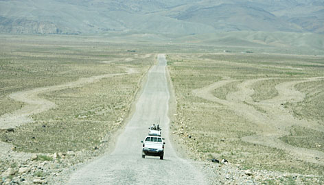 UNOP's trucks travel near the starting point of the road near the Surkh Rod area. Across Afghanistan, fewer than 10% of road miles are paved, leaving many cut off from markets, hospitals and schools.