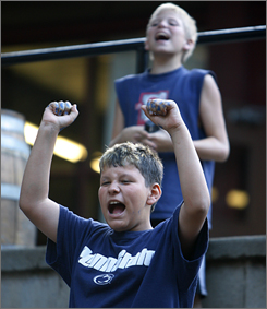 T.J. Greco, 11, and Adam Briggs, 12, behind, get involved in after-dinner activities.