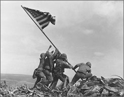 U.S. Marines raise the American flag atop Mt. Suribachi, Iwo Jima, in this Feb. 23, 1945 file photo. A search team is on the island looking for a cave where the Marine combat photographer who filmed the famous World War II flag-raising 62 years ago is believed to have been killed in battle nine days later, military officials said Friday.