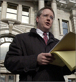 Bill Mercer, the U.S. attorney for Montana, announces indictments against W.R. Grace and Co., along with seven of its senior employees in Missoula, Mont. in this Feb. 7, 2005 file photo. Mercer withdrew his nomination for associate attorney general Friday, four days before he was to testify before the Senate Judiciary Committee. He plans to leave Washington and turn his full attention to his work as U.S. attorney for Montana.