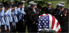 A Charleston Fire Department Honor Guard carries the flag draped casket of firefighter James 'Earl' Allen Drayton to his final resting place at Payne Memorial Gardens on James Island, S.C., Saturday, following a private ceremony.