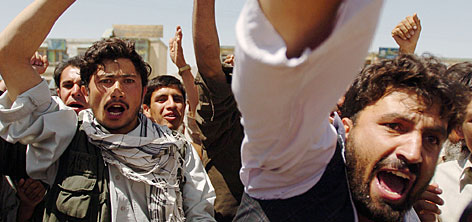 "These Afghan men shouted ""Death to America"" during a June 16 demonstration following the death of a civilian allegedly killed by a U.S. soldier, following a suicide bomb attack in Kabul."