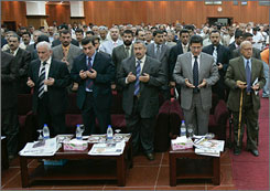 Iraqi journalists offer prayers for fellow journalists killed in Iraq during a ceremony marking the 38th founding anniversary of the Iraqi Journalists Union in Baghdad June 24, 2007. Mahmoud was killed on Iraqi Journalist Day.