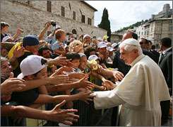Pope Benedict greets children in the town of Assisi, Italy during his visit June 17, 2007, to mark the 800th anniversary of what is known as the conversion of St Francis. The U.S. Conference of Catholic Bishops will release an annual tally of American Catholics this week.