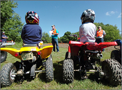 Jim Campbell, center, and Jack Albertson, right, teach an ATV safety course for new ATV riders near Venango, Pa. Campbell is president of the Erie chapter of ATV Traction, a non-profit group that promotes ATV use and safety.