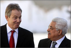 British Prime Minister Tony Blair, left, visits with Palestinian leader Mahmoud Abbas in the West Bank city of Ramallah in December. Blair said Tuesday he was ready to help bring about a solution to the Israeli-Palestinian issue.