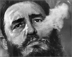 Fidel Castro exhales cigar smoke in this March 1985 file photo during an interview in Havana. According to newly declassified CIA papers released Tuesday, June 26, 2007, the CIA recruited a former FBI agent to approach two of America's most-wanted mobsters and gave them poison pills meant for Fidel Castro during his first year in power.