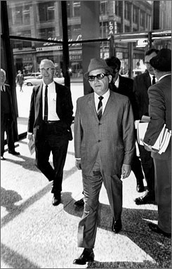Sam Giancana, organized crime boss known as &quot;Momo,&quot; walks into a federal building in Chicago, Ill., May 19, 1965. He suggested using poison pills instead of firearms to assassinate Castro.