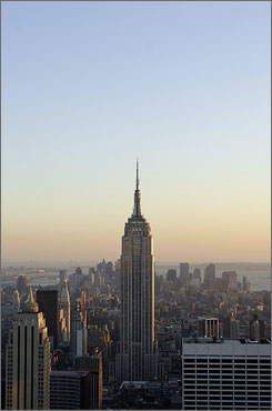 The Empire State Building rises above the Manhattan skyline and New York City's 8.2 million residents.