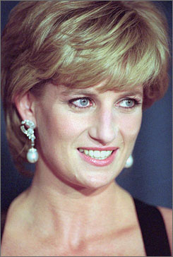 Princess Diana flashes a smile at United Cerebral Palsy's annual dinner at the New York Hilton on Dec. 11, 1995.