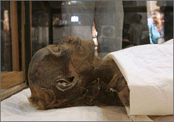 The mummified remains identified as Queen Hatshepsut, ancient Egypt's most famous female pharaoh, lie in a glass case after being unveiled at the Cairo Museum on Wednesday.