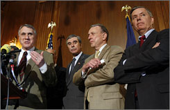 Sen. Jon Kyl (R-Ariz.), left, discusses the defeat of the immigration reform legislation Thursday. From second from left are, Commerce Secretary Carlos Gutierrez, Sen. Arlen Specter (R-Pa.), and Sen. Lindsey Graham (R-S.C.).