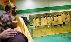 Students get their graduation photos taken at a high school in New Orleans. Valedictorians have become less prominent at ceremonies across the country.