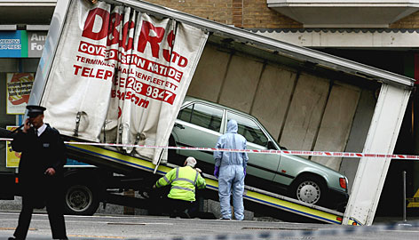 The Mercedes is loaded onto a truck in Haymarket Street. The area around the vehicle was cordoned off Friday morning.