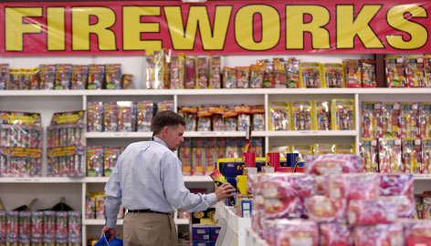 Henry Carrouth of Graham, N.C., shops for fireworks at the Fireworks Giant store near Interstate 20 in North Augusta, S.C., on Monday.