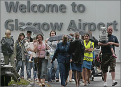 Passengers and staff leave Glasgow airport after a car rammed one of the terminals there.