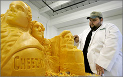 Completing a commission from Cheez-It brand crakers, Troy Landwehr puts the finishing touches on a sculpture of the Mount Rushmore National Memorial, carved from a block of cheddar cheese.