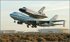 The Space Shuttle Atlantis takes off atop its modified Boeing 747 carrier aircraft from Edwards Air Force Base, Calif. on the first leg of its ferry flight back to the Kennedy Space Center, Sunday, July 1, 2007.