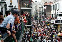 Revelers walk on Bourbon St. in the French Quarter while celebrating Mardi Gras Day in New Orleans, Louisiana February 20, 2007. Engineers with the National Science Foundation say the Quarter is in greater danger now  than pre-Katrina days.