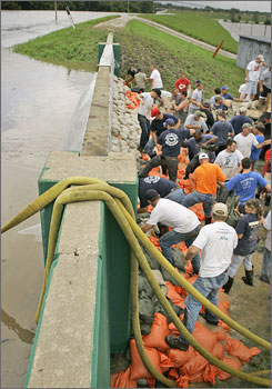 Volunteers sandbag a levy along the Marais Des Cygnes River in Osawatomie, Kan., where the Kansas National Guard was deployed to help with a mandatory evacuation of the city as workers struggled to reinforce a levee on the Marais des Cygne.