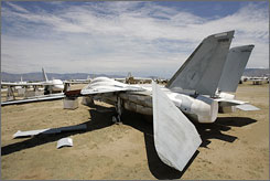 "One of the mothballed F-14 Tomcat fighter jets at Davis-Monthan Air Force Base in Tucson awaits demolition. The Defense Department is taking new security steps and paying a contractor to tear apart old F-14s at the Tucson base, the military's ""boneyard"" for retired jets."