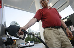 Jim Rohrer of Tucker, Ga., fills up at a Clarkesville, Ga. station. Gas is priced at a 60-degree standard, and drivers in at least 13 states are suing over the lack of temperature-adjustment gear at pumps.